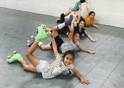 roller skating kids showing their flexibility at Actizone glenfield