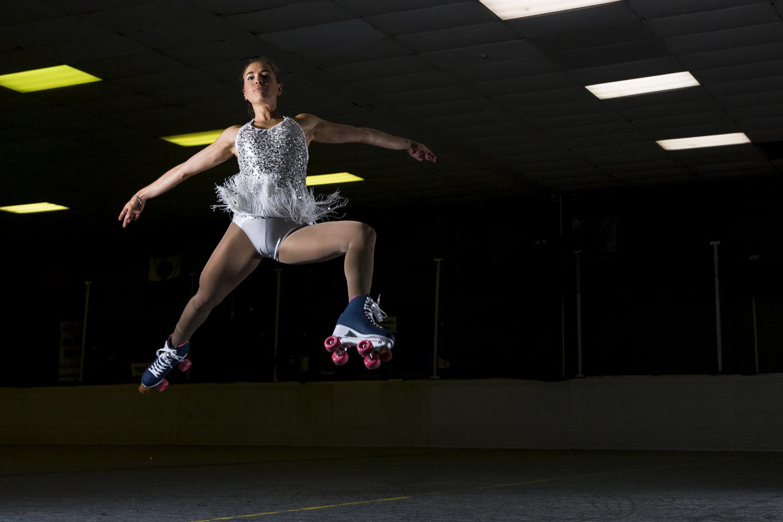 Macarena Carrascosa jumping through the air in Rio Roller skates for a photo shoot